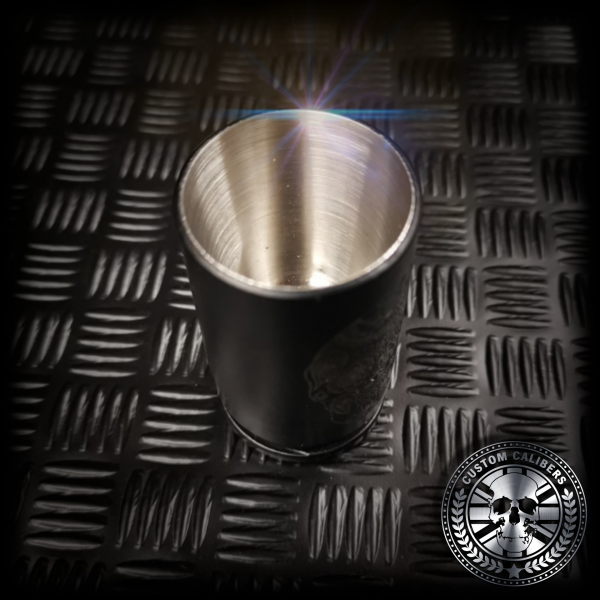 a close up of the inside of a custom calibers 30mm shot glass