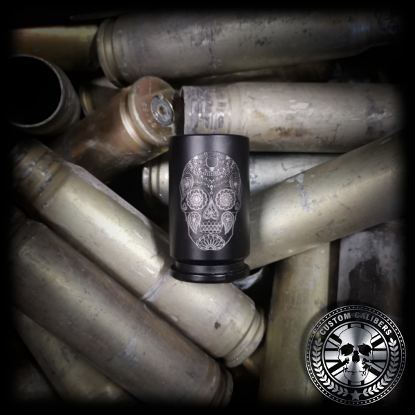 a pile of 30mm A10 Warthog casings showing an awesome matt black 30mm shot glass