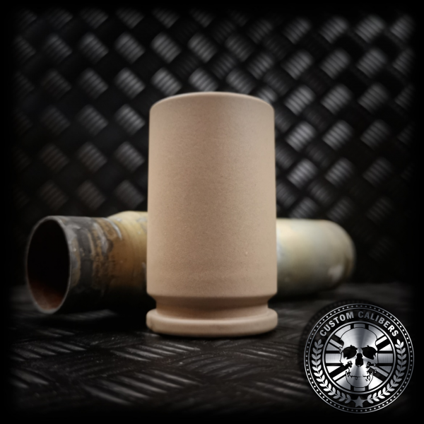 An awesome handmade A10 warthog 30mm shot glass powder coated in a desert tan colour
