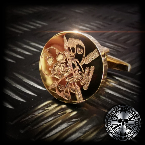 Another awesome close up shot of a solid brass Cuff link engraved with the custom calibers logo on the front