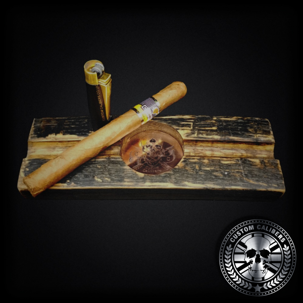 An awesome photo of a cigar ashtray handmade from a whiskey stave barrel with a large Cuban Cohiba cigar and bullet lighter resting on top