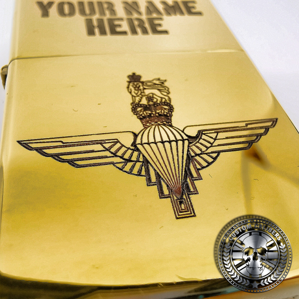 another great close up shot of a polished solid brass flip top lighter engraved with the parachute regiments logo on the front