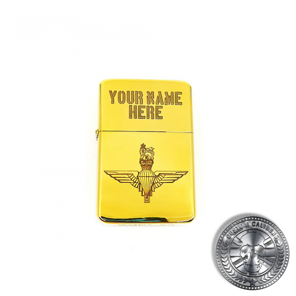 a full range shot of a polished solid brass flip top lighter engraved with the parachute regiments logo on the front
