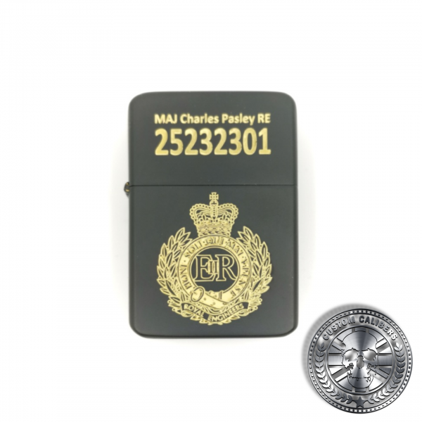 A full view shot of a matt black solid brass flip top lighter engraved with the royal engineers crest on the front with a name and military service number on the lid