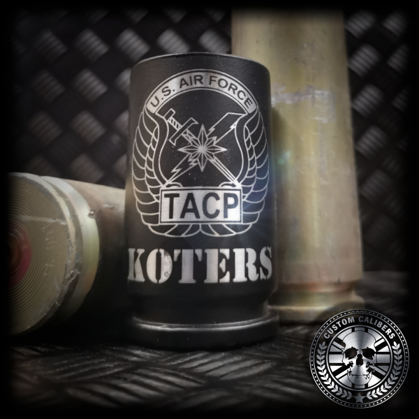 a close up of our matt black 30mm A10 warthog shot glass made from real fired rounds