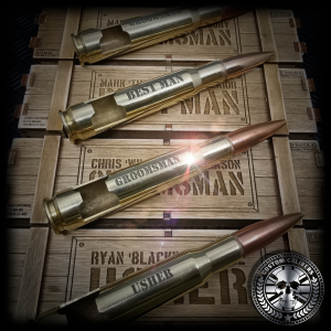 An awesome photo of five polished brass .50 caliber bullet bottle openers made by custom calibers with etched engravings on the front saying Best man, groomsman and Usher resting on top of five wooden ammo crate gift boxes