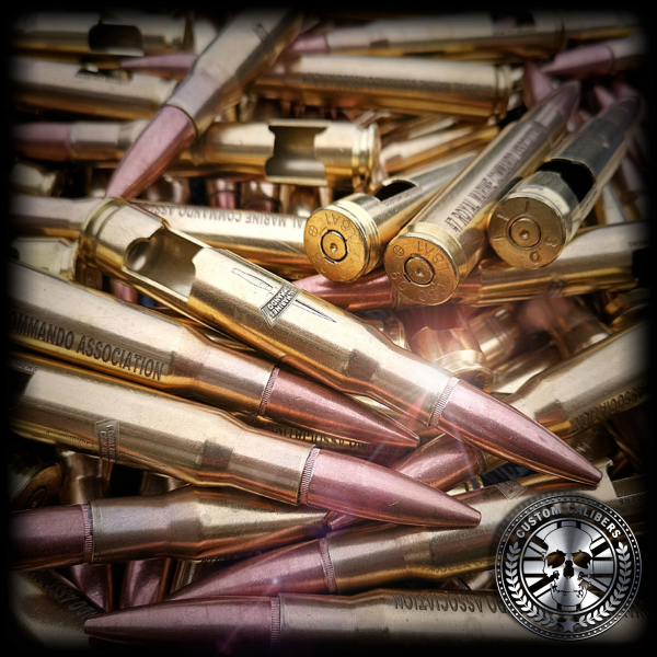 Our final image of many bullet bottle openers on top of each other with engravings