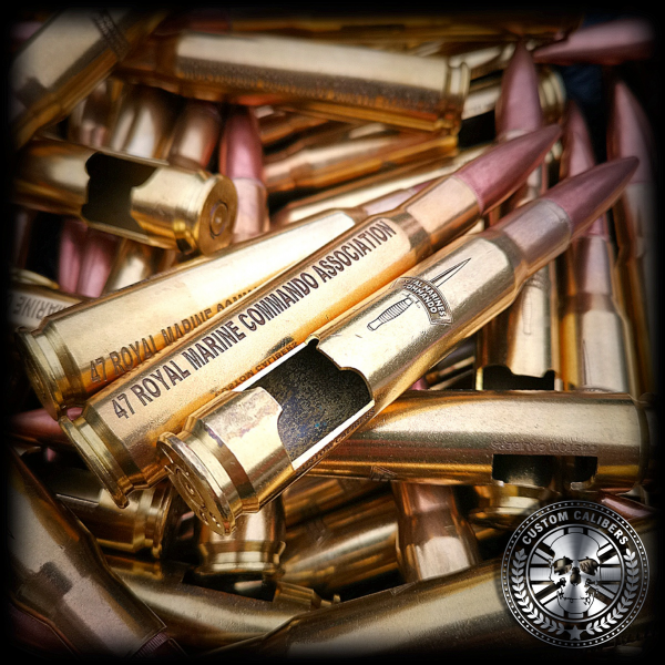 A wondrous photograph of many bullet bottle openers on top of each other with special engravings on them