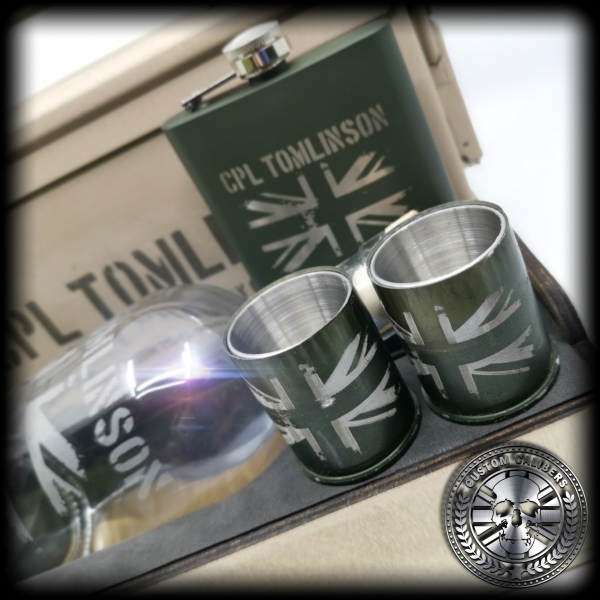 A close up of two custom calibers 40mm grenade shot glasses. They have been engraved with the union jack design