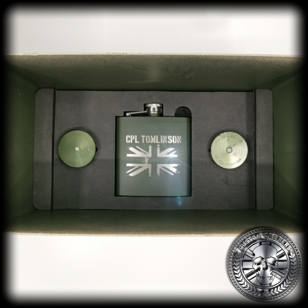 A shot showing the inside of the custom calibers .50 cal ammo tin gift set showing the shot glasses and hipflask inserted inside.