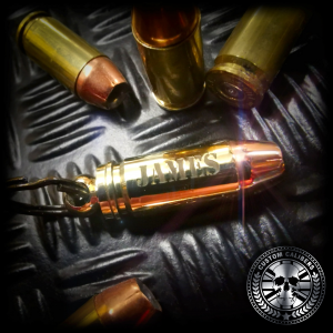 a super shot of one of our 9mm bullet keyrings engraved with the name james