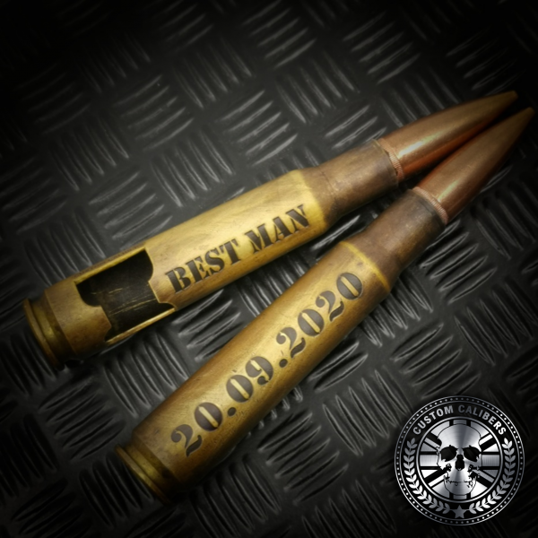 two battle scarred .50 caliber bullet bottle openers deep etched with laser engraved text