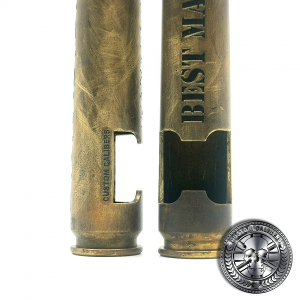 a close up of two battle scarred .50 caliber bullet bottle openers deep etched with laser engraved text