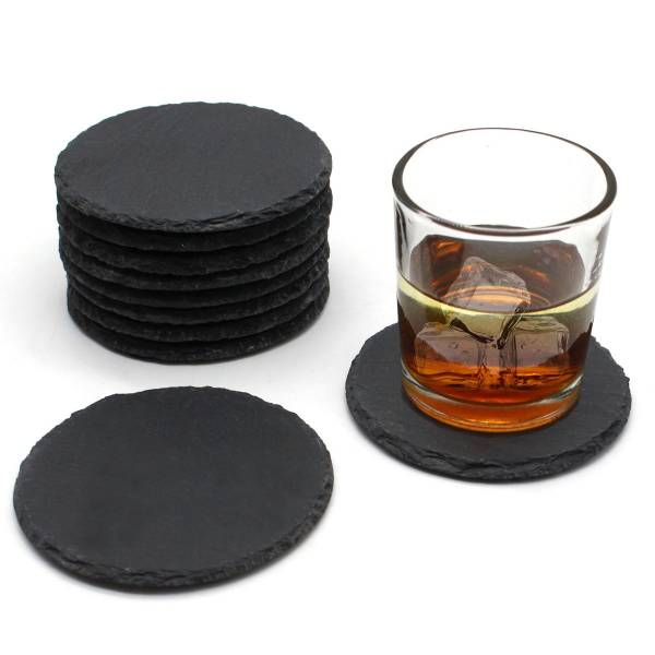 slate coaster round with whisky glass