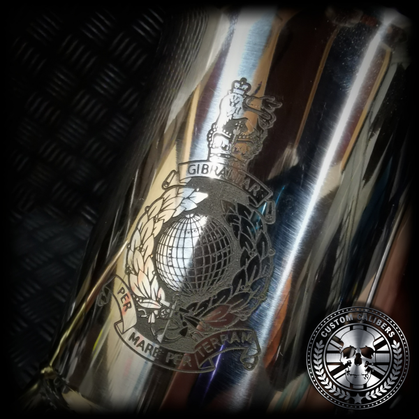 a macro shot of an engraved steel tankard with royal marines crest