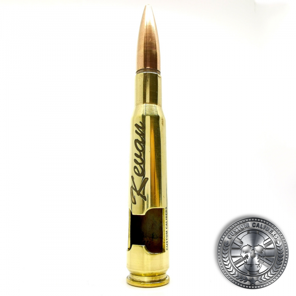 another photo of a polished brass .50 caliber bullet bottle opener deep etched with name
