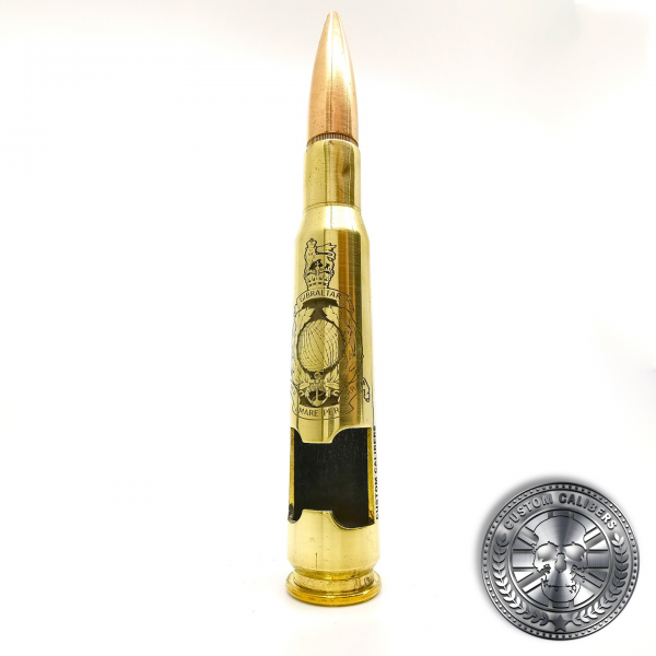 a great photo of a polished brass .50 caliber bullet bottle opener deep etched with a royal marines crest
