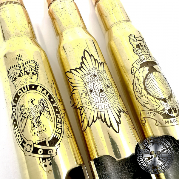 three a great examples of polished brass .50 caliber bullet bottle opener deep etched with military crests