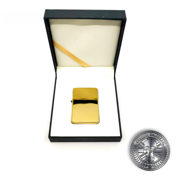 another photo of a highly polished premium solid brass flip top oil lighter inside a luxury gift box