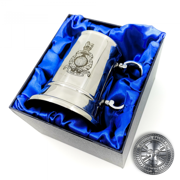 a great photo of a traditional steel tankard deep etched engraved with royal marines crest presented in a silk lined gift box