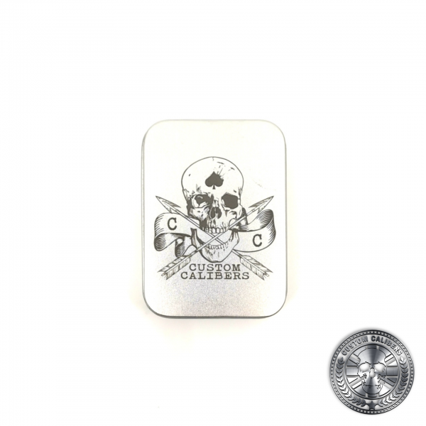 a tin lighter gift box engraved with the custom calibers logo