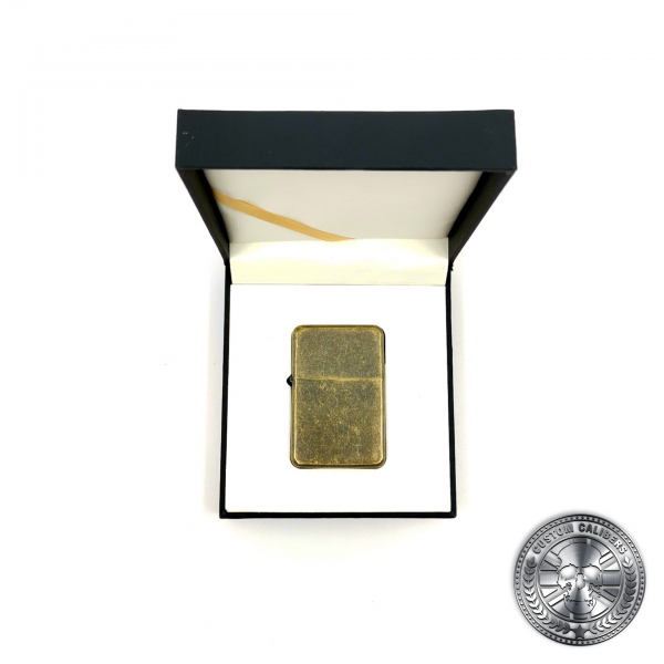a photo of an antique brass effect flip top oil lighter in a luxury gift box