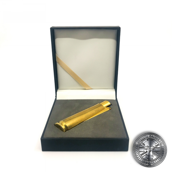 a photo of a real .50 caliber bullet lighter lighter in a luxury gift box made by custom calibers