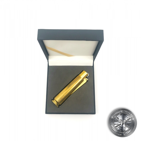 a photo of a real .50 caliber bullet lighter lighter in a luxury gift box