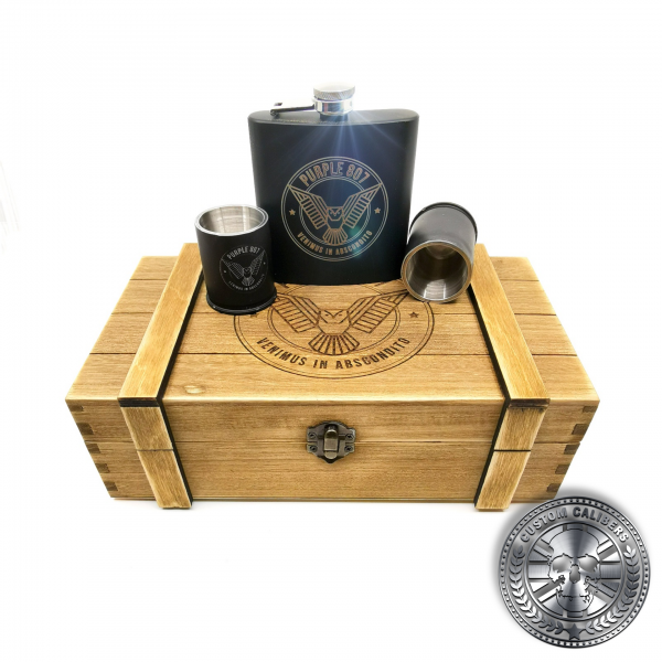 a wooden ammo crate style gift box with deep etched laser engraved logo with grenade shot glasses and hipflask