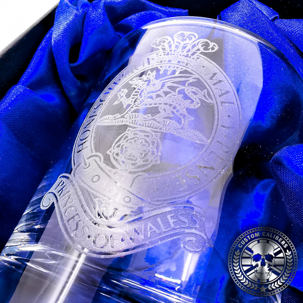 a close up macro shot of a military laser etched whisky tumbler presented inside a silk lined gift box