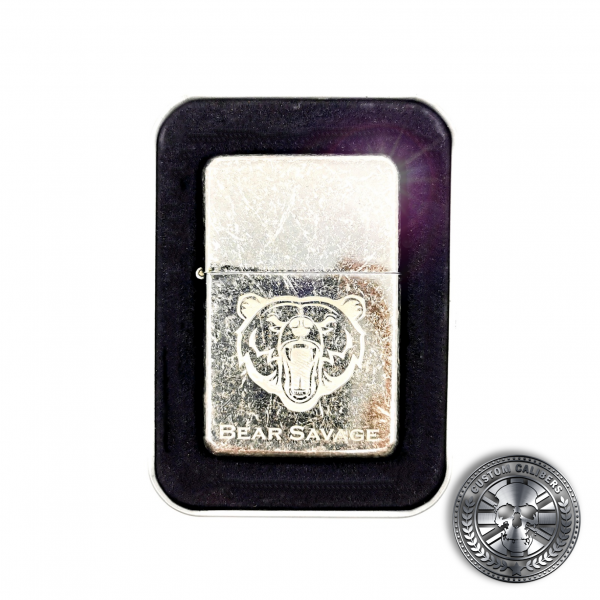 a close up of an antique effect steel flip top oil lighter with engraved logo laser engraved