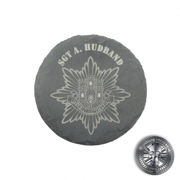 an engraved slate coaster with the royal anglian regiment crest