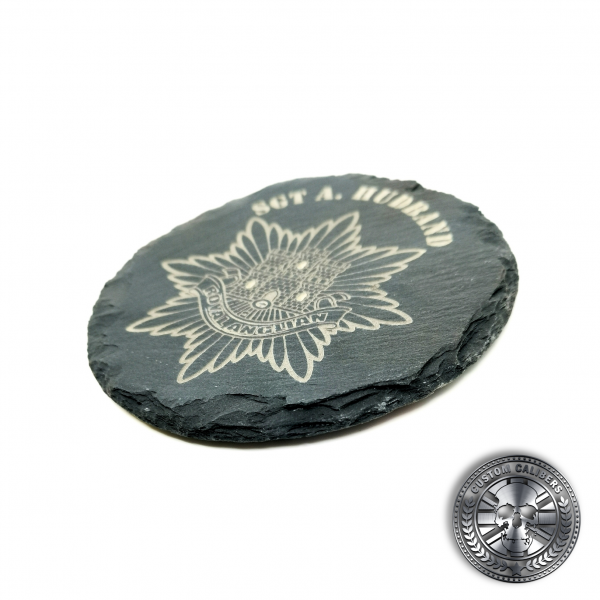 another photo of an engraved slate coaster with the royal anglian regiment crest