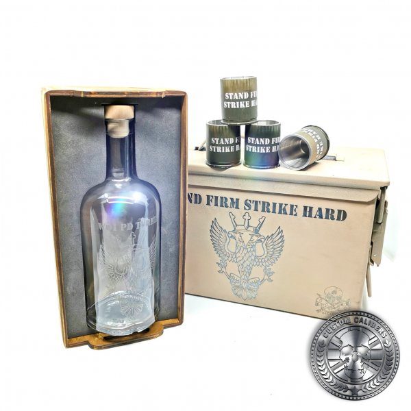 another great photo of a desert tan ammo tin gift box showing off an engraved bottle and four 40mm GMG shot glasses