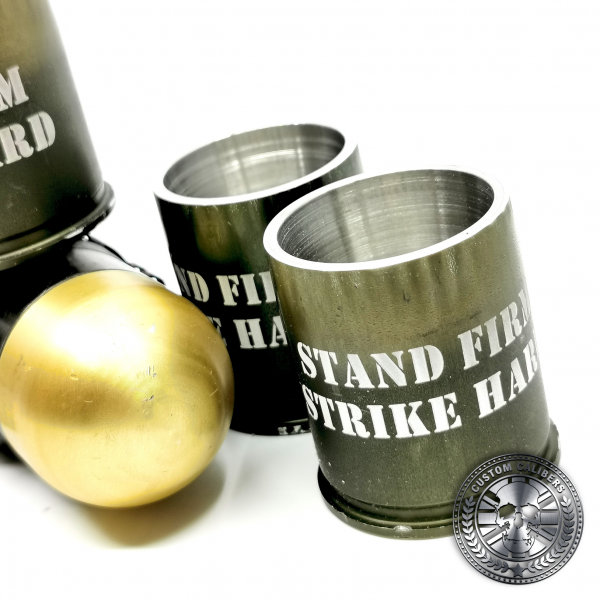 a great shot of several 40mm GMg grenade shot glasses made from real once fired cases