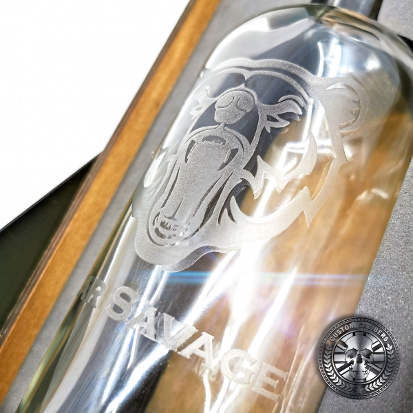 a close up of an engraved whisky bottle gift set